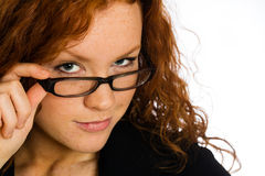 flirting-woman-looking-over-her-glasses-28837143[1]
